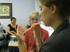 Participants Practice Straw Phonation Exercise