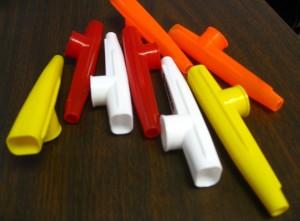 kazoo to practice minimizing vocal strains